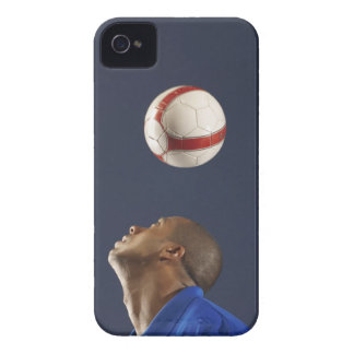 Man bouncing soccer ball on his head 2 iPhone 4 cases