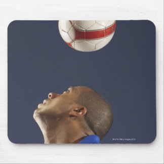 Man bouncing soccer ball on his head 2 mouse pad