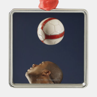 Man bouncing soccer ball on his head 2 Silver-Colored square decoration