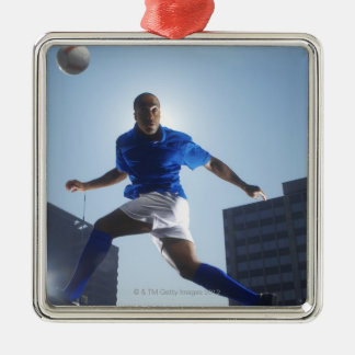 Man bouncing soccer ball on his head Silver-Colored square decoration
