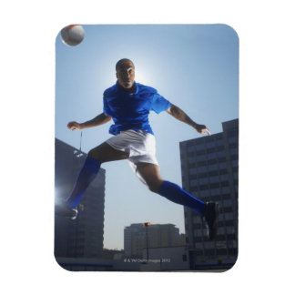 Man bouncing soccer ball on his head rectangular photo magnet