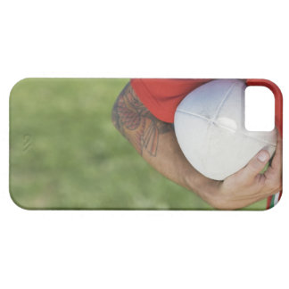 Man carrying rugby ball case for the iPhone 5