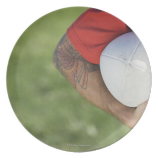 Man carrying rugby ball party plate