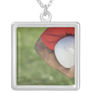 Man carrying rugby ball silver plated necklace