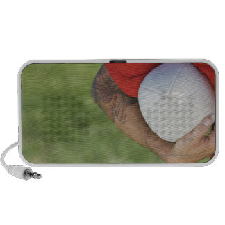 Man carrying rugby ball mp3 speakers