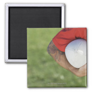 Man carrying rugby ball square magnet