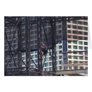 Man climbing up a steel ladder greeting cards