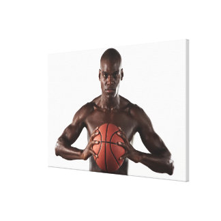 Man clutching basketball canvas print