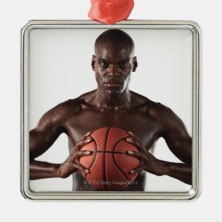 Man clutching basketball christmas ornament