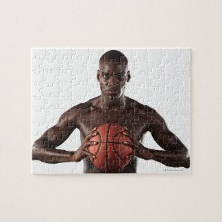 Man clutching basketball jigsaw puzzle