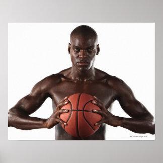 Man clutching basketball poster