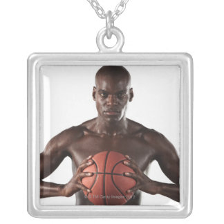Man clutching basketball silver plated necklace