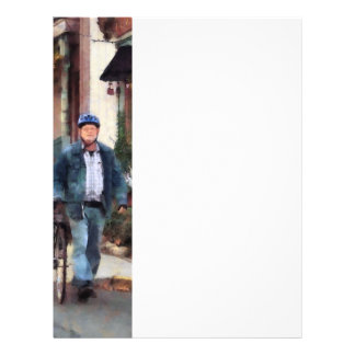 Man Crossing Street With Bicycle Flyers