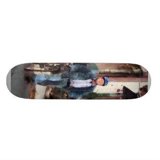 Man Crossing Street With Bicycle Skateboard Deck