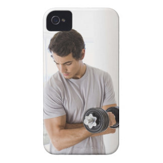 Man doing arm curls with weights iPhone 4 Case-Mate cases