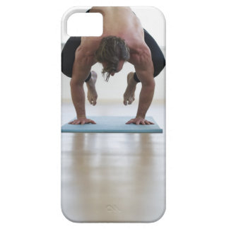Man doing workout on yoga mat case for the iPhone 5
