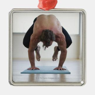 Man doing workout on yoga mat christmas tree ornament