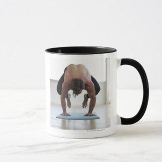 Man doing workout on yoga mat mug