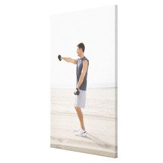 Man Exercising on Beach Canvas Print