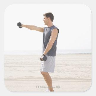 Man Exercising on Beach Square Sticker