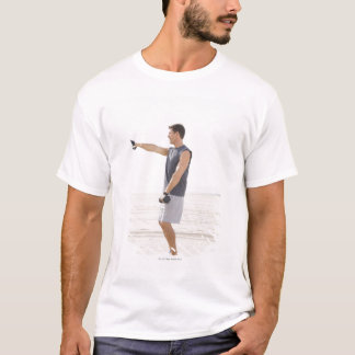 Man Exercising on Beach T-Shirt