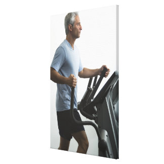 Man exercising on Stairmaster Canvas Print