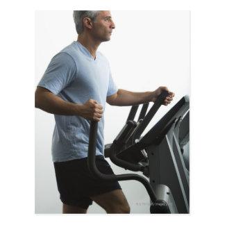 Man exercising on Stairmaster Postcard