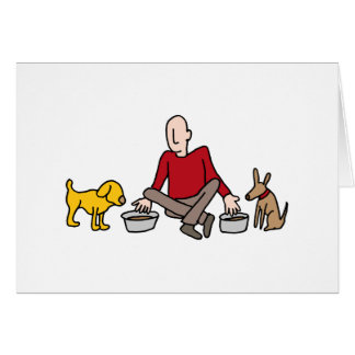 Man feeding his two dogs greeting card