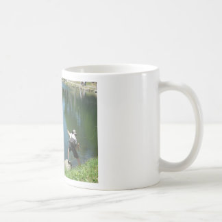 Man fly fishing on a mountain lake coffee mug