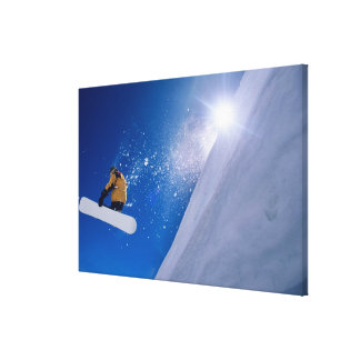Man flying through the air on a snowboard with canvas print