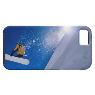 Man flying through the air on a snowboard with iPhone 5 case