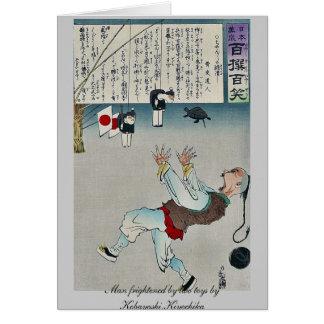 Man frightened by two toys by Kobayashi,Kiyochika Note Card