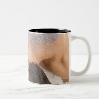 Man getting salt rub coffee mug