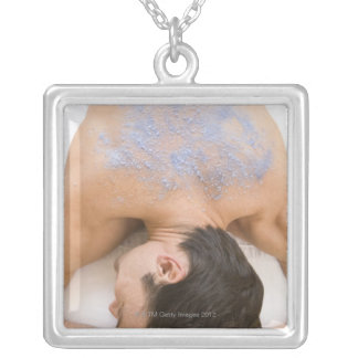 Man getting salt rub silver plated necklace