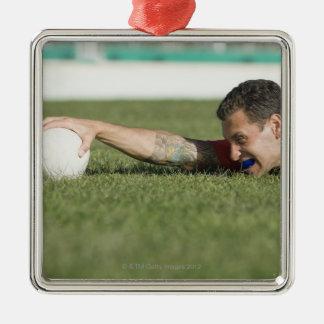 Man grabbing rugby ball christmas ornament