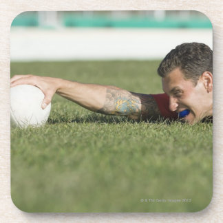 Man grabbing rugby ball drink coasters