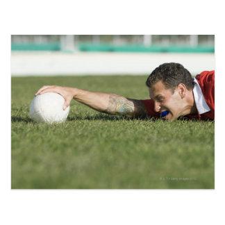 Man grabbing rugby ball post card