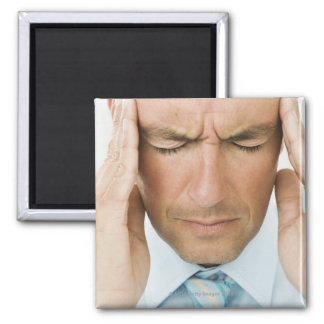 Man hands on head magnet