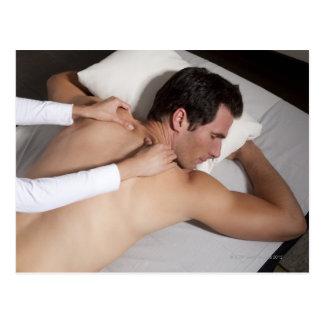 Man having a back massage from woman postcard
