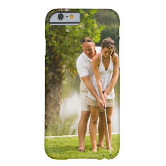 Man helping woman golf barely there iPhone 6 case