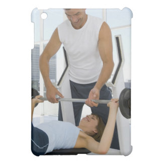 Man helping woman with weightlifting case for the iPad mini