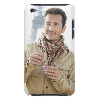 Man holding a disposable cup with the Eiffel iPod Touch Covers