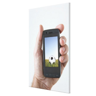 Man holding a mobile phone canvas print