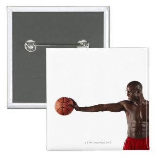 Man holding basketball 15 cm square badge