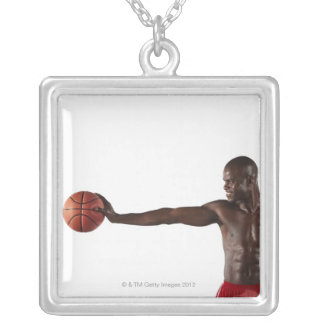 Man holding basketball square pendant necklace
