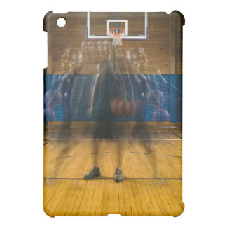 Man holding basketball standing on court, case for the iPad mini