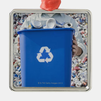 Man holding blue bin christmas ornament