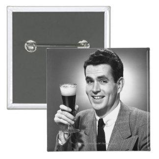 Man holding glass of beer in studio B&W 15 Cm Square Badge