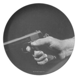 Man Holding Gun Plates
