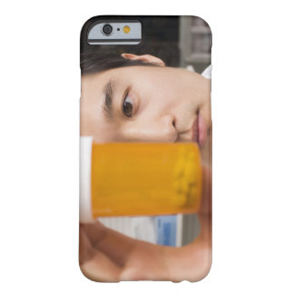 Man holding pill bottle barely there iPhone 6 case